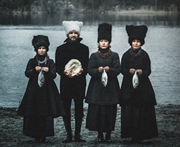 dakhabrakha - pilgrims standing in front of a lake